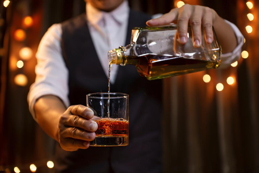 Bartender Serving Bourbon Whiskey