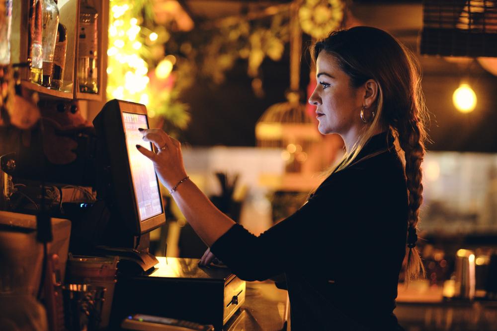 bartender ringing in drink orders