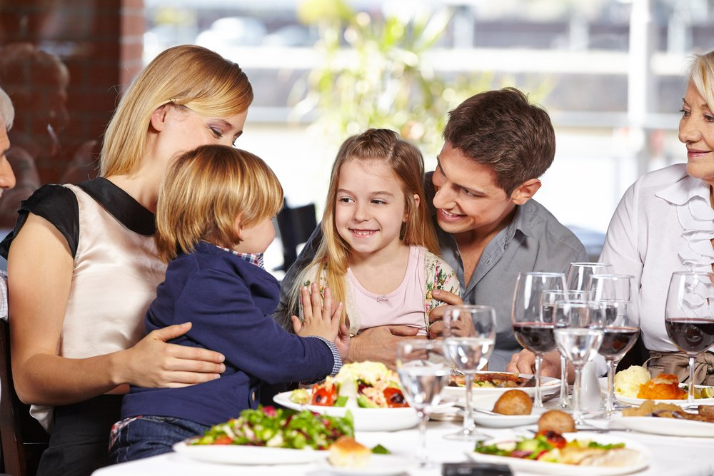 lovely family eating delicious food in Avalon restaurant