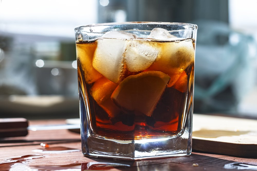 rum and coke in a glass with ice